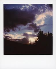 Polarado Sunset 2 (tobysx70) Tags: polaroid originals color 600 instant film slr680 polarado sunset county road 53 granby colorado co clouds cloudporn blue sky sunbeam pine tree silhouette polaradoone 072418 toby hancock photography