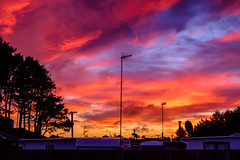 ºº Waitarere winTer sKy ºº (m+m+t) Tags: dscf57671 mmt meredithbibersteindesign newzealand northisland waitarere beach hydrabadmotorcamp camping winter sunset evening sky clouds silhouette fujixt1 fujixseries fujimirrorless 35mm trees