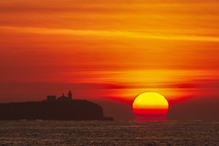 Scintillating Sunrise over the Farne Islands, Northumberland (MelvinNicholsonPhotography) Tags: farneislands northumberland sunrise lighthouse sea ocean orange sky clouds burningsun bamburgh island