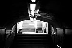 In the entrance (pascalcolin1) Tags: paris12 femme woman entrée entrance métro subway ombres shadows lumière light escalier stairs staircase reflets reflection photoderue streetview urbanarte noiretblanc blackandwhite photopascalcolin 50mm canon50mm canon