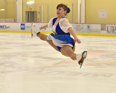 Flying with the greatest of ease... (R.A. Killmer) Tags: blue costume smile beauty woman spin spinning skate skater skates charity show lemieux center fun talented powerful graceful leap fly