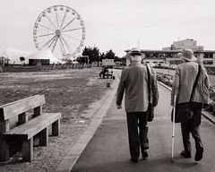 Thrill seekers (raymorgan4) Tags: ferris wheel park bench walking stick senior citizens oap cardiff bay barrage fairground attraction funfair