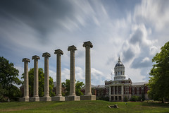 The Columns and Jesse Hall (Notley Hawkins) Tags: httpwwwnotleyhawkinscom notleyhawkinsphotography notley notleyhawkins 10thavenue haida mizzou columns thecolumns jessehall campus universityofmissouri columbiamissouri bocomo boonecountymissouri july afternoon sky clouds cloudysky nd ndfilter neutraldensity neutraldensityfilter haidafilter 12stop longexposure grass tree francisquadrangle