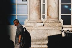 the weight (FButzi) Tags: genova genoa liguria italy italia street man building sun shadow