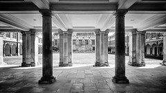 under the wren library (khrawlings) Tags: cambridge trinity college wren library quad cloister pillars columns bw blackandwhite monochrome building architecture university england