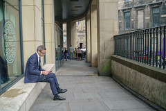 business man sitting edinburgh (iamthecandleman) Tags: man business sit seat suit listen music phone headphones pizza express wall wait smart sony a7r samyang 35mm