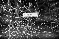 can i help you not to hurt anymore? (Daz Smith) Tags: dazsmith fujixt20 fuji xt20 andwhite bath city streetphotography people candid citylife thecity urban streets uk monochrome blancoynegro blackandwhite mono window broken craked hurt sticker