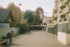 Via Amarcord (1973) (goodfella2459) Tags: nikonf4 cinestill50 35mm c41 film analog colour viaamarcord1973 street rimini italy federicofellini road cinema buildings trees