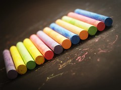 Colored chalk on a blackboard background (www.icon0.com) Tags: chalk color red teacher yellow line leaf blackboard orange drawing paint type pink frame blue student school first education silly background board rainbow ground