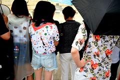 Α Raining Summer  Day : Pac Man (Storyteller.....) Tags: athens summer day rain raining people back colors man girl woman pacman waterproof flowers