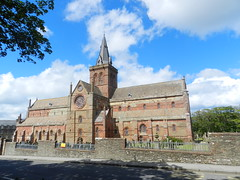 St Magnus Cathedral, Kirkwall, Orkney, June 2018 (allanmaciver) Tags: st magnus cathedral kirkwall orkney island red sandstone spire clock church trees weather snadow shade larhe building historic scotland north allanmaciver