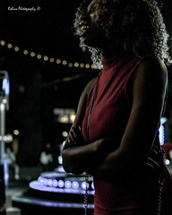 Red (Robica Photography) Tags: robicaphotography d3200 2018 streetphotography straatfotografie tilburg people face evening lights attraction funfair fair amusement detilburgsekermis woman colourful walking purse afro dress red smile
