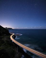 Lights home (Jay Daley) Tags: sydney nightphotography car headlights driving highway scenic stars long exposure light trails bridge seacliffbridge