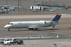 N466SW, Phoenix Sky Harbor, February 26th 2004 (Southsea_Matt) Tags: n466sw deltaairlines deltaconnection skywestusa bombardier crj200er unitedstatesofamerica usa arizona phoenix skyharbor kphx phx february 2004 winter canon 10d transport airplane aeroplane aircraft regionaljet