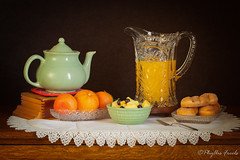 Still Life Good Morning (Phyllis Freels) Tags: phyllisfreels blueberries brown fork glass juice lace orange pastry pineapple pitcher stilllife teapot wood