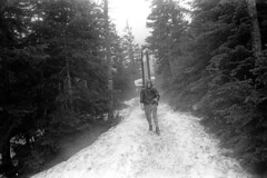 052470 03 (ndpa / s. lundeen, archivist) Tags: nick dewolf nickdewolf may blackwhite photographbynickdewolf tuckerman ravine tuckermanravine whitemountains whitemountain nationalforest hike hiking mtwashington mountwashington snow hikers bw nh 1970 1970s newhampshire monochrome blackandwhite trail tuckermanravinetrail child boy hood skis gear backpack johnnorton man hiker pipe pipesmoker pipesmoking