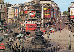 Piccadilly Circus: 1970 (Leonard Bentley) Tags: piccadillycircus coventrystreet shaftesburyavenue jarthurdixon postcard greatbritain johnboorman leothelast marcellomastroianni billiewhitelaw cannesfilmfestival bestdirector dvd londonpavilion monchérichocolates cherries liqueur darkchocolate ferrero italian british french wrigleyschewinggum usa wembley plymouth 1911 1927 1970 london uk marsgroup eros traffic bus