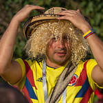 Colombian soccer fan with blonde wig and straw hat thumbnail