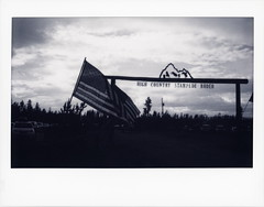Rodeo Silhouette (tobysx70) Tags: fujifilm fuji instax wide monochrome bw black while instant film bigpitchers 500af camera rodeo silhouette high country stampede county road 73 fraser colorado co sign mountain horse us usa flag stars stripes old glory clouds sky polaradoone polarado 072118 toby hancock photography