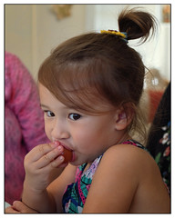 Aria - how to eat a tomato (marneejill) Tags: aria little girl cute brown eyes tomato hand