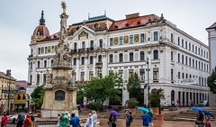 2018 - Hungary - Pécs - County Hall (Ted's photos - For Me & You) Tags: 2018 cropped hungary nikon nikond750 nikonfx pécs tedmcgrath tedsphotos vignetting széchenyisquare pecsszéchenyisquare széchenyisquarepecs pécshungary pecshungary umbrellas backpack sculpture trinitystatue pecstrinitystatue trinity statue trinitystatuepecs streetscene street people peopleandpaths pathsandpeople redrule red