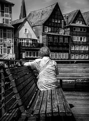 Reminiscing. (Mister G.C.) Tags: blackandwhite bw image streetshot streetphotography photograph candid people woman lady female old elderly bench frombehind leadinglines unposed monochrome urban town city sonya6000 sonyalpha a6000 mirrorless telephoto zoom lens sel18105 18105mm sonyglens sony18105mmepz f4 mistergc schwarzweiss strassenfotografie niedersachsen lowersaxony deutschland europe