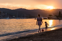 The truck on a leash (Tiomax80) Tags: beach walk family love beachwalk babygirl baby girl sunset sun plagedesbaumettes plage des baumettes agay esterel var varois 83 riviera french frenchriviera cote dazur tiomax nikon d610 nikonfr cotedazur sunlight endoftheday beautiful france playa sand sea sailboats bay massifesterel massif sky golden goldenhour sungoesdown