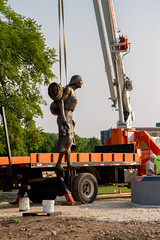 Suspended Female (Lester Public Library) Tags: bronze sculpture bronzesculpture monument spiritoftherivers spiritoftheriversmonument art artist wallen skipwallen rtwallen tworiverswisconsin lakemichigan tworivers americanindians nativeamericans