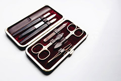 Manicure set on white background. (wuestenigel) Tags: pedicure iron scissors sharp cut accessory beauty manicure background set macro cosmetics clipper hygiene file white view closeup scissor isolated collection tools fingernail toenail polish blade tool treatment accessories box sets care equipment top metallic object cuticle steel finger fashion nail