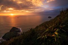 New Plymouth Sunset II (Luc Stadnik) Tags: sunset newzeanland paratitu newplymouth tasmansea ocean clouds sky glow reflection