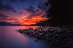 Sundown at Happy Point (dharnan) Tags: sunset golden orange leefilters britishcolumbia northernbc bc lake rocks dark sky water bigstopper 9hardgrad grad