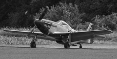 """P51D """"MISS HELEN"""" AT THE END OF THE RUNWAY AT EAST KIRKBY (Russell Photographic Images) Tags: p51d misshelen mustang monochrome blackandwhite tair3phs45300mm eastkirkby lincolnshire pentax manualfocus pentaxks2 aircraft warbirds aeroplanes lincolnshireaviationheritagecentre"""