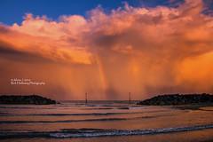 Rain Sunset Rainbow (rhfo2o - rick hathaway photography) Tags: rhfo2o canon canoneos7d elmer elmersands bognorregis westsussex beach sea seaside sky sand sunset seadefences channelmarker rain rainbow rainbowcolours waves horizon