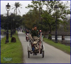 Vietnam, Hue City Boards 20180212_153745 DSCN3133 (CanadaGood) Tags: asia asean seasia vietnam vietnamese hue lake tree pedicab people person canadagood 2018 thisdecade color colour