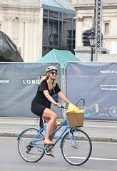 Trafalgar Square Cyclist (Waterford_Man) Tags: girl cycle cyclist wheels bike london