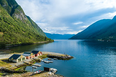 Aerial view of Sognefjord  with docks and fishing boats in Norway (spot-on.lt) Tags: vegetation sailing landscape blue green cloudy water mountains thickclouds cityscape aerial midday color bank norway fishermen summer drone building pier travel fjord nord docks colourful boat nival europe sognefjord sea above architecture city ship tourism