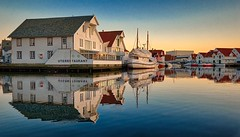 Skudeneshavn, Norway (Vest der ute) Tags: xt2 norway rogaland karmøy sea seaside water buildings sky reflections mirror boat restaurant houses fav25 fav200