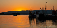 Oban Sunset (w.mekwi photography [here & there]) Tags: lights trees goldenhour uk scotland sunset highlands hills water reflections oban silhouette boats wmekwiphotography nikond800 landscape
