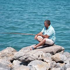 Angler in Kuşadası (dbrugman) Tags: xt1 fujifilm streetphotography street sea turkey kusadasi türkiye kuşadası angler