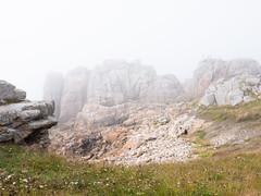 Misterious Cliffs (Gijs Peijs) Tags: france legouffredeplougrescant landscape zeemist legouffre cliffs mist bretagne rotsen bloei panorama lowtide eb rocks bluesky plougrescant cliff landschap ocean oceaan kliffen meadow frankrijk heide klif fog heather rock wide blossom