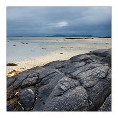 Gathers and Rock (gerainte1) Tags: barra hebrides scotland sea sky shore beach sand rock colour