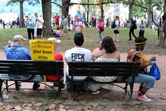 protesters take a break on a park bench (wortenoggle) Tags: park bench washington protest supremacist