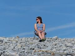 Glasllwyd (Andy WXx2009) Tags: outdoors beach rocks pebbles sky candid girl people portrait style streetphotography sunglasses brunette blue woman femme female minidress sunbathing beauty chair sitting valeofglamorgan fashion sexy legs wales europe seaside