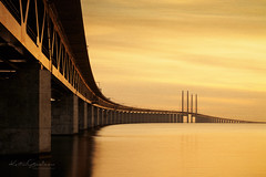 Golden (Karsten Gieselmann) Tags: 1240mmf28 5gold5 braun brücke em5markii elemente europa farbe filter gelb gold graufilter hss haida himmel luft mzuiko malmo meer metallic microfourthirds nd nd1000 natur neutraldensityfilter neutraldichtefilter olympus oresundbridge reise sliderssunday sonnenuntergang sweden textur wolken air brown clouds color elements golden kgiesel m43 mft nature sea sky sunset texture travel yellow öresundbrücke malmö skånelän schweden