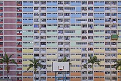 Pastel Hoops (UrbanCyclops) Tags: hongkong building facade architecture apartments flats windows asia city urban metropolis cityscape lines colorful tower block skyscraper housing abstract