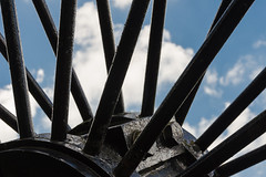 Winding wheel (mikeplonk) Tags: southwales wales mining mine coal coalmine colliery pit cambrian clydachvale tonypandy rct highcontrast sky clouds black blue white memorial nikon d5100 18140mm kitlens polarisingfilter unusualangle rhonddacynontaf