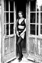 Preparing for the day (piotr_szymanek) Tags: blackandwhite outdoor balcony door entrance woman young skinny portrait window stockings bra panties lingerie face eyesoncamera hand highheels 1k 20f 50f 5k 100f 10k 20k 30k 200f 40k 50k angelise