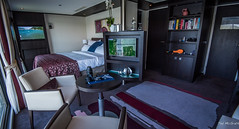 2018 - Danube River Cruise - Avalon Passion - Royal Suite (Ted's photos - For Me & You) Tags: 2018 avalonwaterways cropped nikon nikond750 nikonfx tedmcgrath tedsphotos vignetting avalonpassion avalonpassionroyalsuite bed kingbed tv ballcap hat cameralens wineglasses