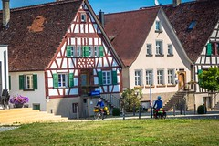 Stephanie and Andrew cycling along the EuroVelo6 route in Germany through a lovely little town.