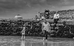 Beach Family (creativegaz) Tags: family blackwhite seaside puddle people fun water holidy kids mums bnw nocolour coast group sandysea